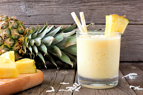 photo of a healthy pina colada smoothie in glass