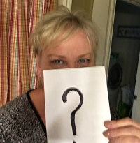 questions about Lipedema surgery | photo of Denise holding up a piece of paper with a question mark on it